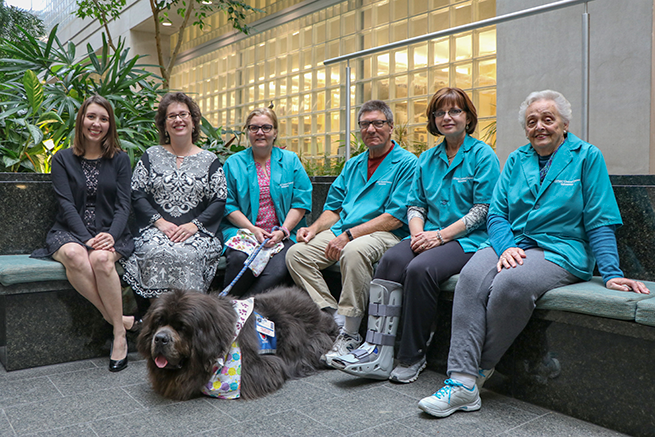 Laurin with her assistant, Denise Tommaso, and four members of the Hillman CancerCenter volunteer team.