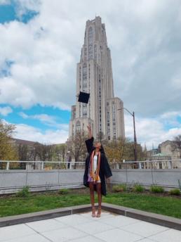 Betsy tosses her graduation cap at Pitt