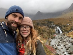 Elizabeth and Kevin pose on the Isle of Skye in Scotland
