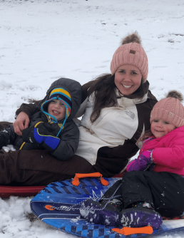 Jeni in the snow with her kids