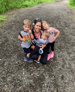 Jennifer smiles with her three children