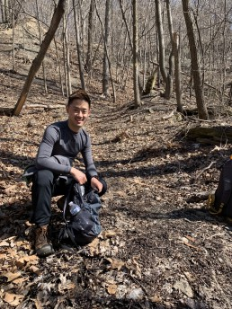 Alex smiles while hiking the Rachel Carson Trail
